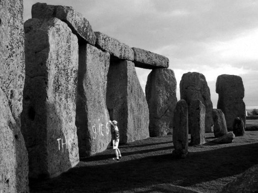 Ben writing 'The Gits' on Stonehenge