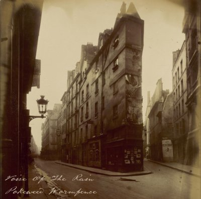 The front cover of the Pokeweed Wormfence booklet which is a Eugène Atget photograph from either 1908 or 1912 of narrow Parisian Streets with multi-story buildings looking old and battered - Vieille Cour, 22 rue Quincampoix.