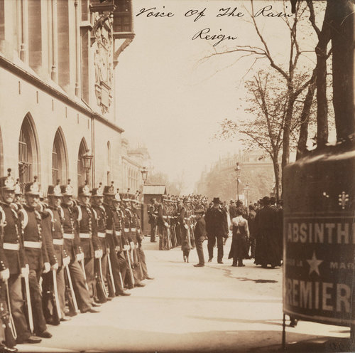 Front cover of the Reign album by Voice Of The Rain, the photograph Gardes Républicains devant le Palais de Justice from about 1900 by Eugène Atget. It's of soldiers on parade with the public looking on. An advert for absinthe can be seen in the bottom right corner