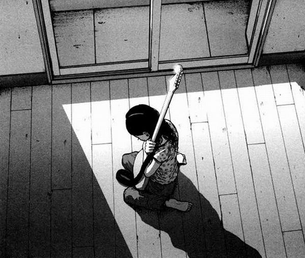 The protagonist of the Japanese comic Solanin clutches the guitar which belonged to her dead partner
