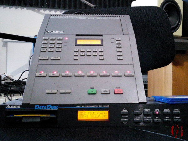 Photograph of late 80s vintage Alesis HR16 drum machine and Data Disk midi disc storage unit.