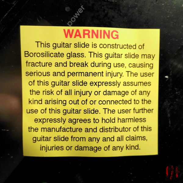 A notice that comes with a Rock Glass guitar slide warning of the dangers of permanent injury if it should break which the user has to take all responsibility for.