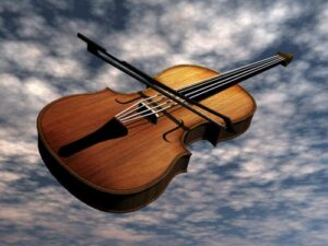 A violin in the sky amongst clouds