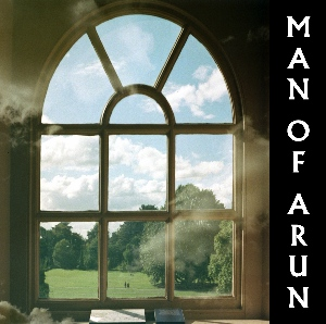 The front cover of the Man Of Arun release Amateur Hour which is a double exposed photograph of an old window with clouds seemingly floating about inside