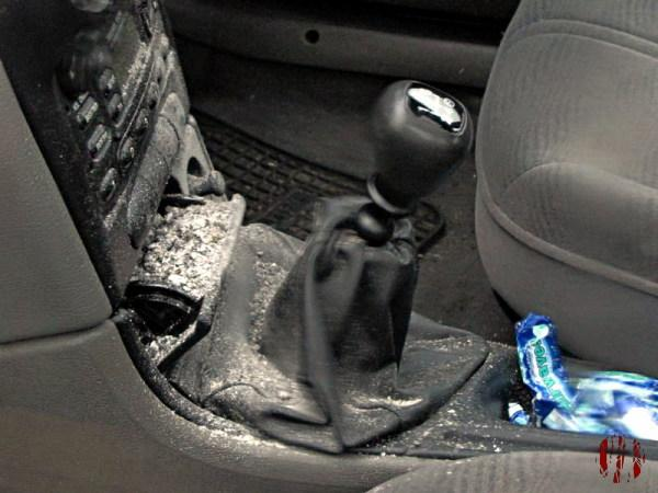 A considerably overflowing car ashtray.