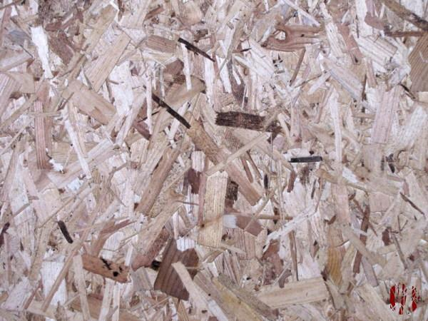The patchwork pattern of chip board seen from above.