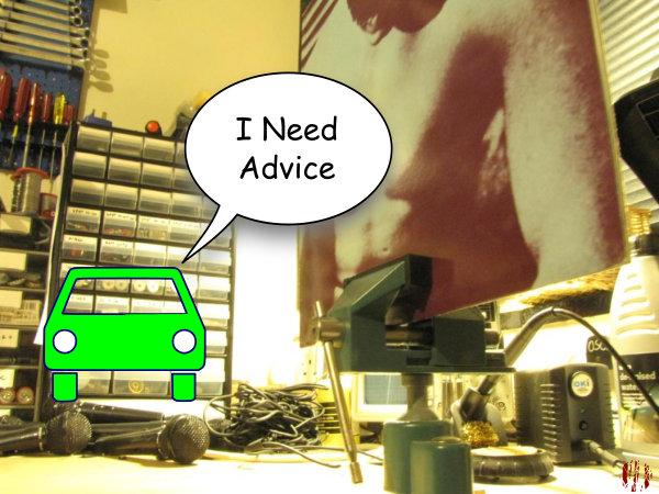 """A cartoon car says, """"I need advice"""" whilst a copy of The Smiths first LP is in the foreground in a vice."""