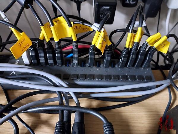 A 16 way USB hub nearly fully populated
