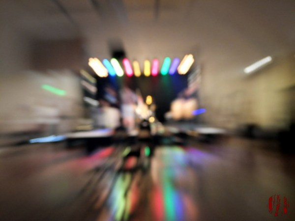 The stage of the Drill Hall Horsham in a colourful blur of lighting for a video shoot by the band with learning difficulties The Coasters.