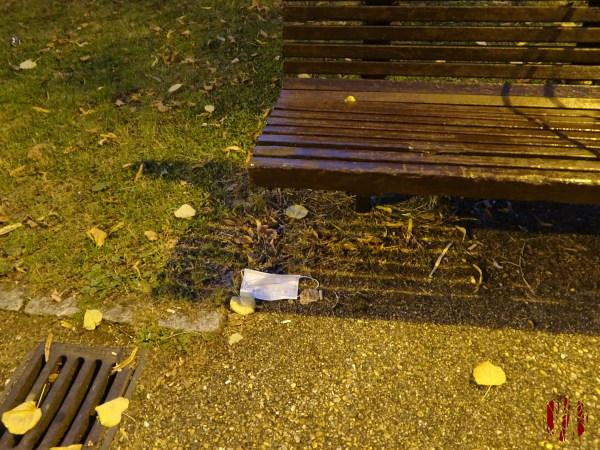 A discarded face mask below a bench in Horsham Park in the time of Coronavirus Covid-19.