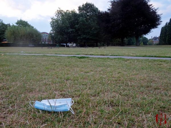 A view of Horsham Park seen over a discarded face mask in the time of Coronavirus Covid-19.