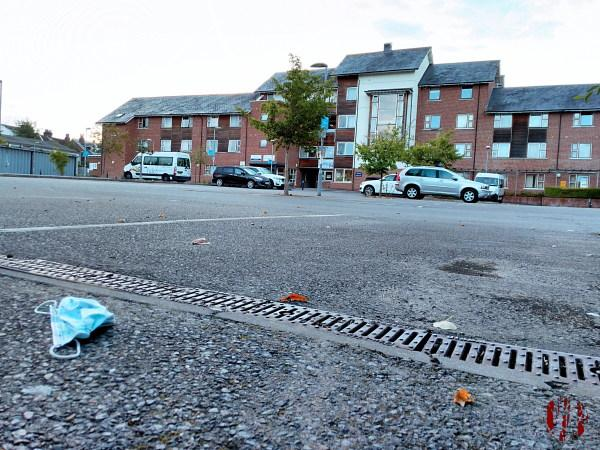 The car park behidn the Drill Hall Horsham seen over  a discarded face mask in the time of Coronavirus Covid-19.