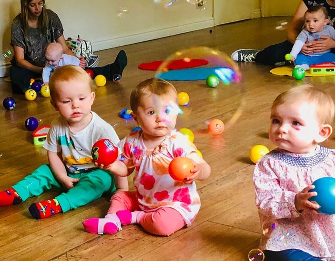 Babies enjoying bubbles and music at a JoJo's Music class