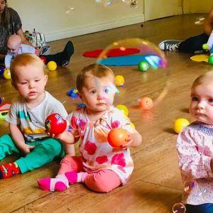 Babies enjoying bubbles and music at a JoJo's Music class