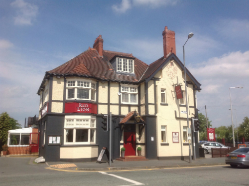 The outside of the Red Lion Pub in Lowton