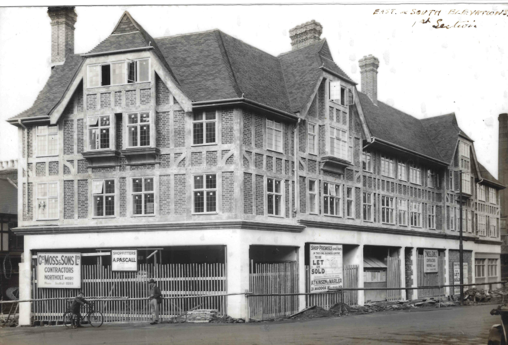Historic photo of a premises in London owned by George Moss & Sons