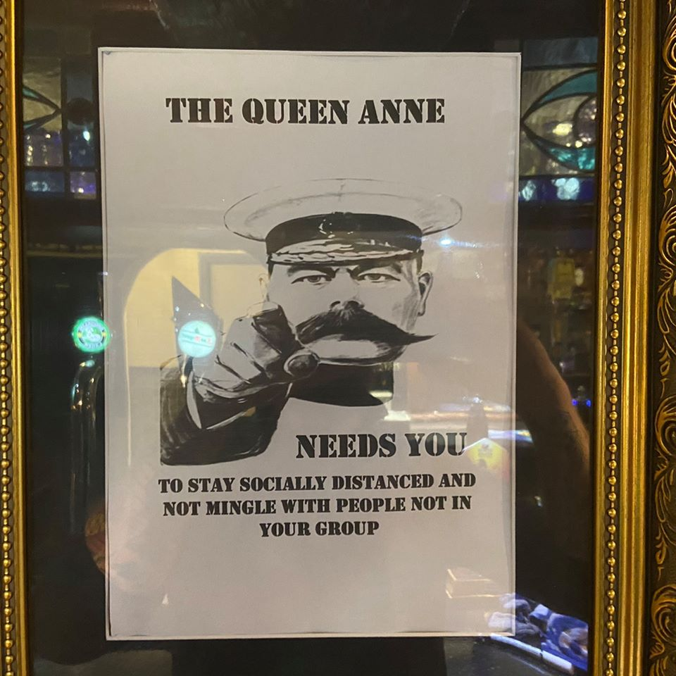 Poster in the Queen Anne pub Golborne tells people to keep their social distance