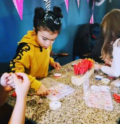 Children enjoying a craft activity at a party organised by Love Lee Parties in Newton-le-Willows