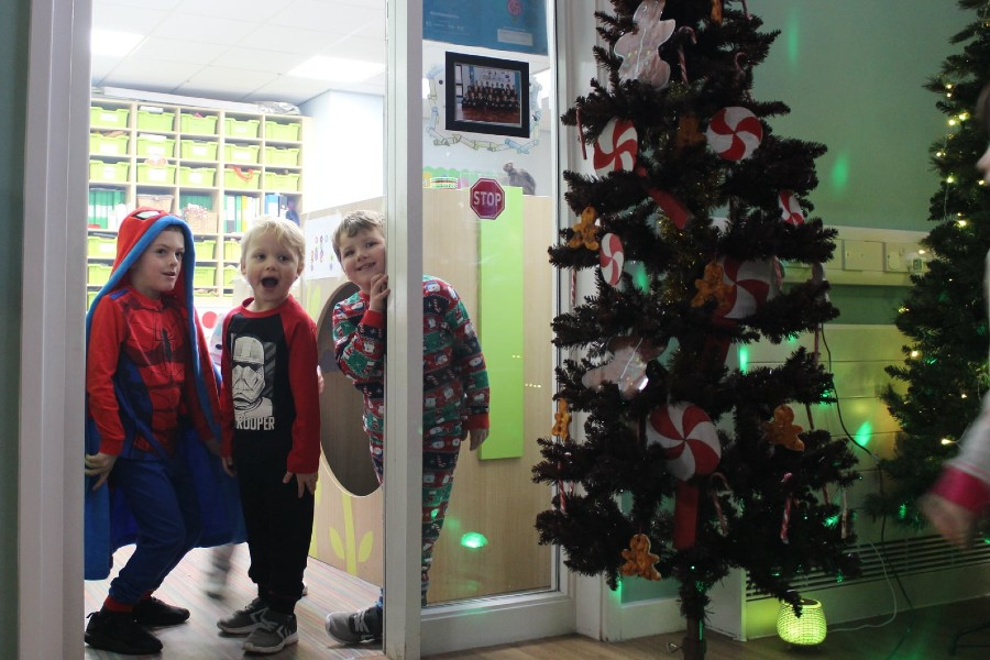 Children smiling to see the decorations for the first time