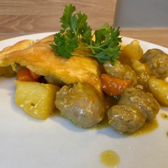 Slice of golden sausage pie