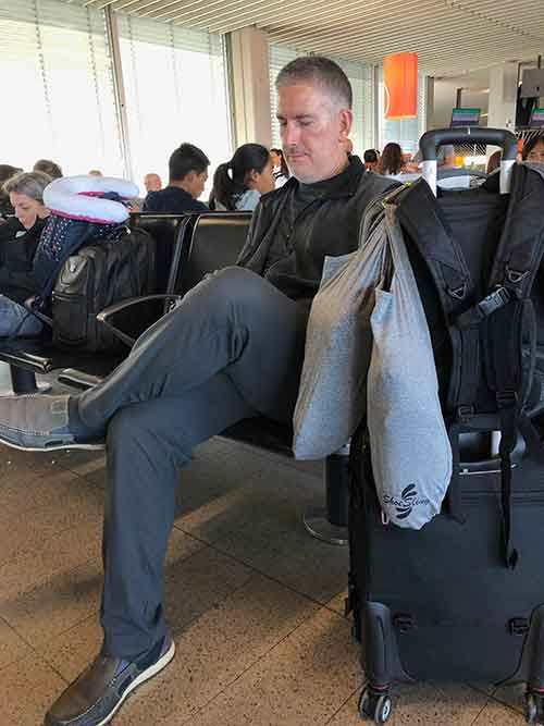 ShoeSling attached to backpack in airport waiting for flight
