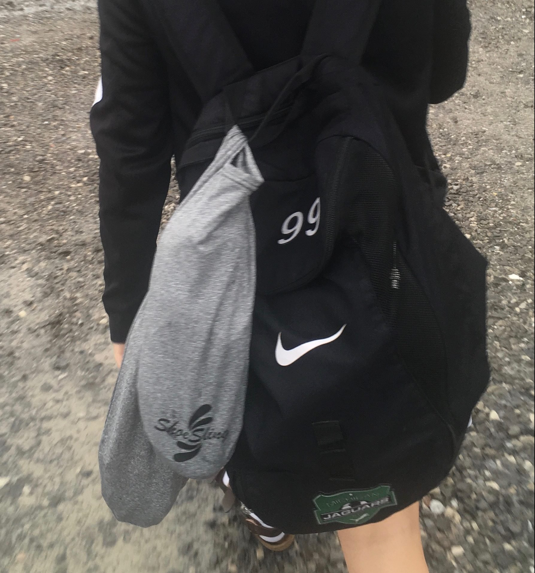 Young woman with ShoeSling attached to her soccer gear bag