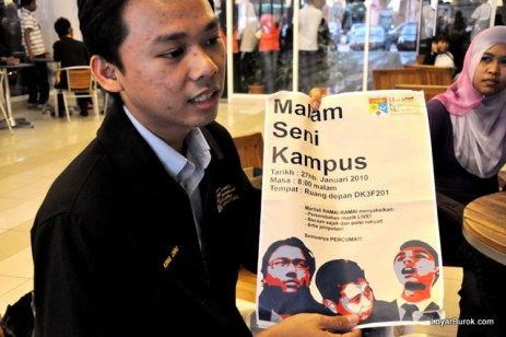 King Chai proudly showing us the poster for an appreciation night concert they organised