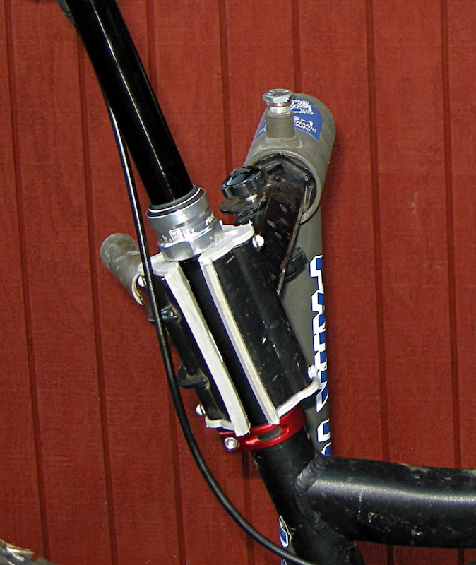 Tips that will make the job go smoothly:<br>The first and most expensive mistake that most Reverb owners make is clamping the hose, hose fitting and upper slider part of the Reverb in the bike stand. If you've wrecked a Reverb post like this, you are a member of a sizable club. We'd advise the rest of you to loosen the frame clamp and slide the post up as high as you need to clamp the fat part of the Reverb below the seal-head in the bike stand. Also remember to move the hose from harm's way before you swing the clamp shut. You'll get best results with the bike angled so that the remote lever is higher or at least level with the bleed port on the seatpost. keep the front wheel in place with a bungee cord or a length of rope between the rim and frame.