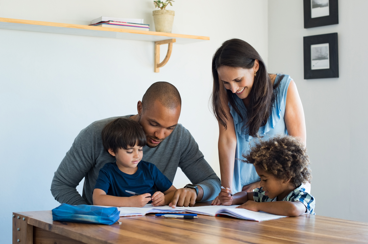 Parents helping children with homework