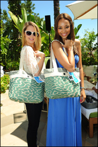Two ladies with matching swag bags smile for the camera at Yoplait Greek Beverly Hills Event