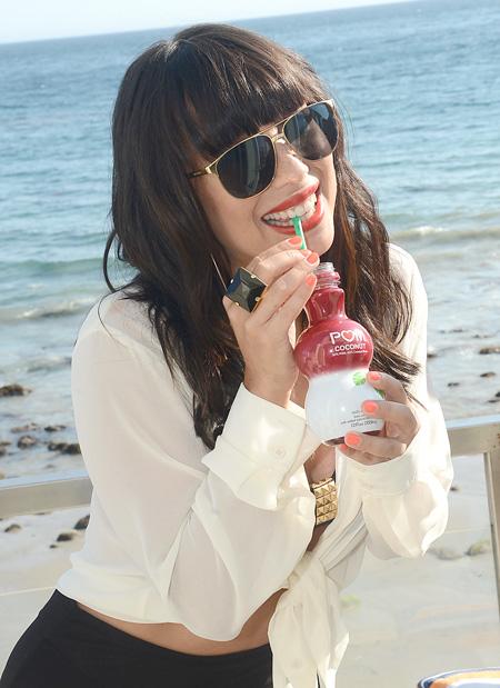 photo of Cheryl Burke sipping drink at Malibu Beach House