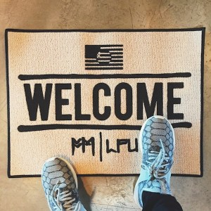 Photo of a Fort Minor 'Welcome' mat.