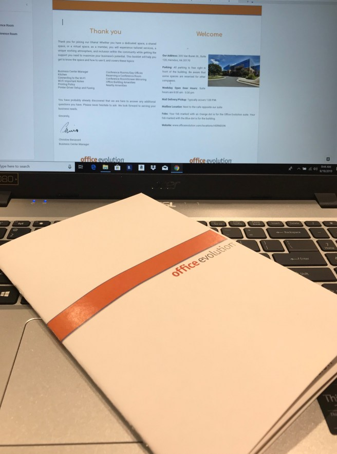 """A booklet with an orange stripe that says """"office evolution,"""" sitting on a keyboard. Above, the text from inside the booklet."""