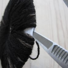 Sådan klippes garndullen op