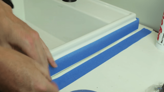 Use painters tape for a perfect edge when caulking