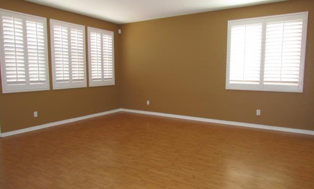 This Family Room will fit the biggest sectional sofa!