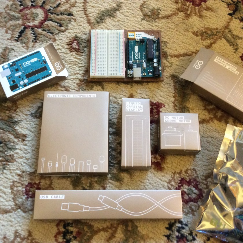 Arduino kit with the boxes laid out on carpet