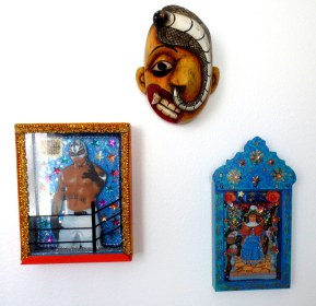 Update of a classic: modern day retablos from Mexico City. Topped with goony, Red Grooms-like mask from Sri Lanka.