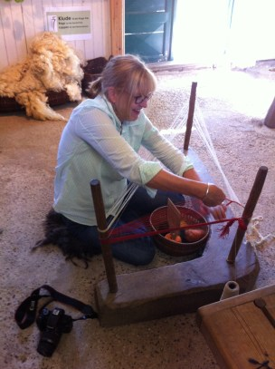 Dr Mary Harlow learning to make a warp on a warp weighted loom