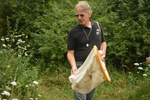 Mike demonstrating the use of a sweep net, used to collect insects from grass and brush