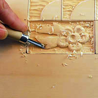 straight chisel shaving in wood carving