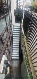 steel staircase by LSJ Engineering, at Old Burlington St, Mayfair, London