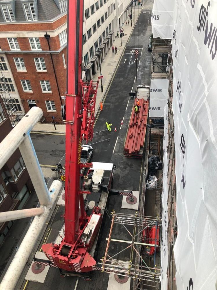 view of a vertical crane as part of steel work at Mortimer St, London