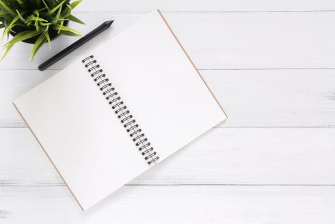 Image of a pen and notebook. This image represents the viewers taking note of the 4 tips I offer for how to show yourself grace.