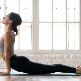 Image of person doing yoga (upward facing doc) as yoga was a critical part of Carrie's physical therapy plan for pain during sex.
