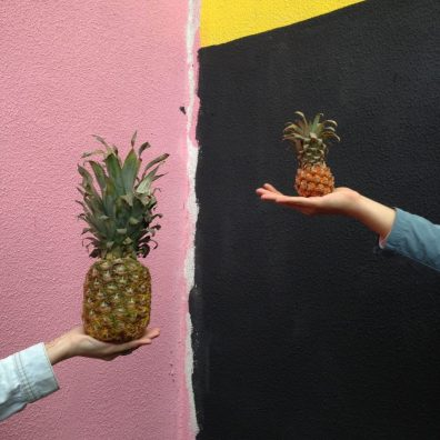 Image of a side by side comparison of two pineapples. The one one the left is much bigger than the right. This image represents how I would compare my vulva to others.