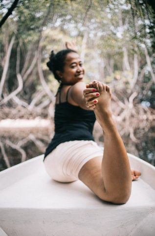 Image of a person relaxing and doing yoga.