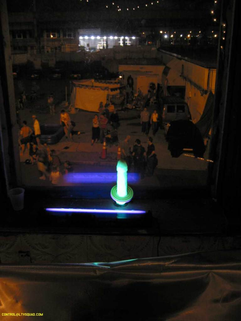 Glow in the dark dildo in the window @ the spanking circus - 2003