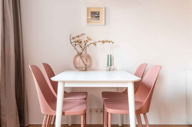 dining table and pink chairs in light dining room