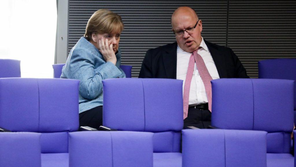 Thủ tướng Đức Angela Markel và Bộ trưởng Kinh tế Peter Altmaier. Ảnh: Kay Nietfeld.